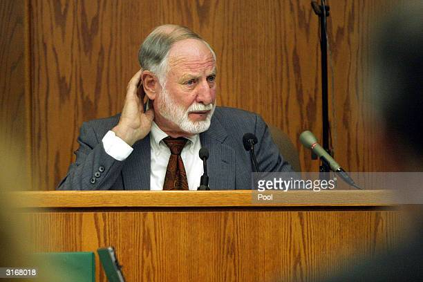 John T Buttres a registered professional engineer from Texas listens to a question from defense attorney Michael Kelly during proceedings in the...