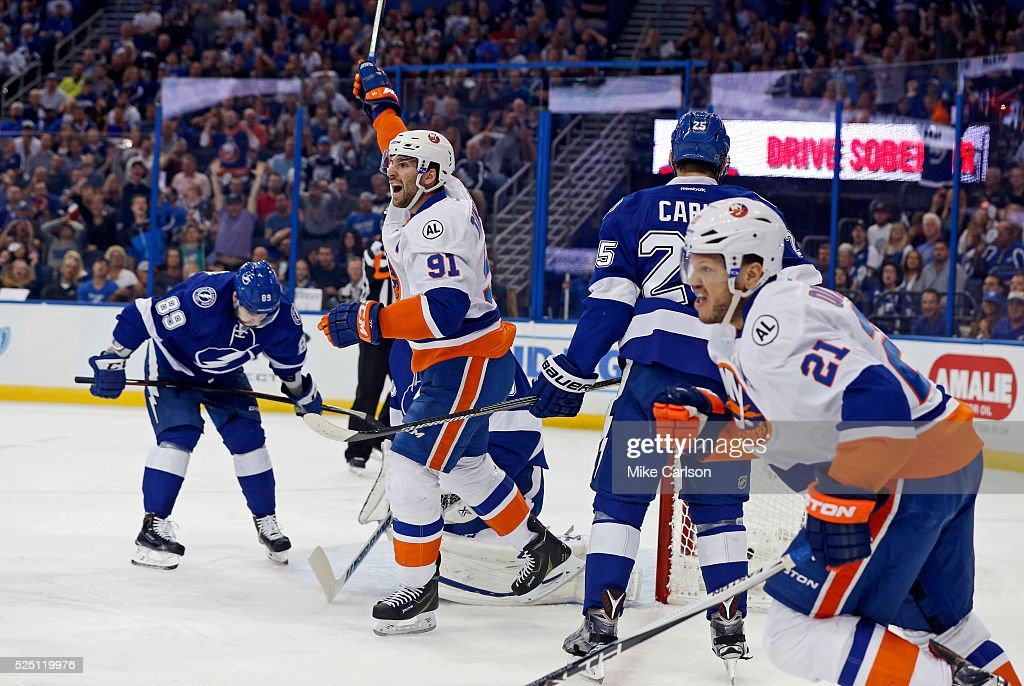 <a gi-track='captionPersonalityLinkClicked' href=/galleries/search?phrase=John+Tavares&family=editorial&specificpeople=601791 ng-click='$event.stopPropagation()'>John Tavares</a> #91 and <a gi-track='captionPersonalityLinkClicked' href=/galleries/search?phrase=Kyle+Okposo&family=editorial&specificpeople=540469 ng-click='$event.stopPropagation()'>Kyle Okposo</a> #21 of the New York Islanders celebrate a goal as <a gi-track='captionPersonalityLinkClicked' href=/galleries/search?phrase=Nikita+Nesterov&family=editorial&specificpeople=7895381 ng-click='$event.stopPropagation()'>Nikita Nesterov</a> #89 of the Tampa Bay Lightning reacts during the first period in Game One of the Eastern Conference Second Round during the 2016 NHL Stanley Cup Playoffs at Amalie Arena on April 27, 2016 in Tampa, Florida.