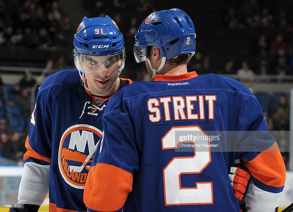 John Tavares #91 and Mark Streit #2 of Team Blue skates talk during a scrimmage match between players of the New York Islanders and Bridgeport Sound Tigers on January 16, 2013 at Nassau Veterans Memorial Coliseum in Uniondale, New York.