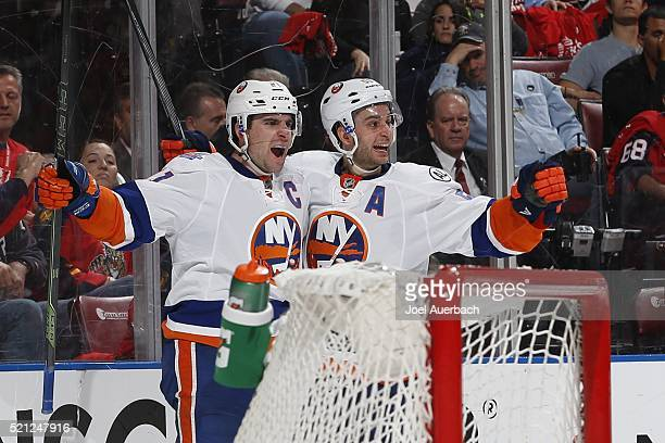 John Tavares celebrates his second period goal with Frans Nielsen of the New York Islanders against the Florida Panthers in Game One of the Eastern...