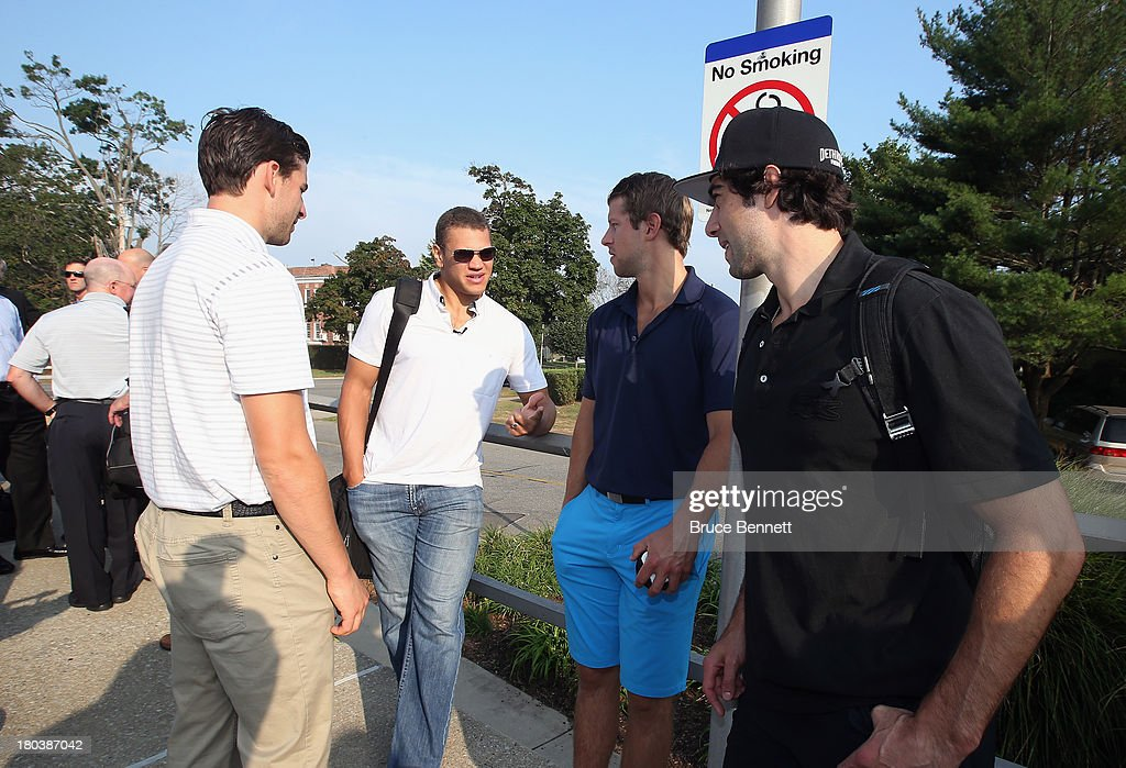 <a gi-track='captionPersonalityLinkClicked' href=/galleries/search?phrase=John+Tavares&family=editorial&specificpeople=601791 ng-click='$event.stopPropagation()'>John Tavares</a>, <a gi-track='captionPersonalityLinkClicked' href=/galleries/search?phrase=Kyle+Okposo&family=editorial&specificpeople=540469 ng-click='$event.stopPropagation()'>Kyle Okposo</a>, <a gi-track='captionPersonalityLinkClicked' href=/galleries/search?phrase=Josh+Bailey+-+Ice+Hockey+Player&family=editorial&specificpeople=3321456 ng-click='$event.stopPropagation()'>Josh Bailey</a> and <a gi-track='captionPersonalityLinkClicked' href=/galleries/search?phrase=Matt+Moulson&family=editorial&specificpeople=3365493 ng-click='$event.stopPropagation()'>Matt Moulson</a> of the New York Islanders wait to board the Long Island Rail Road train at Garden City that is headed for their first practice at the Barclays Center on September 12, 2013 in Brooklyn borough of New York City.