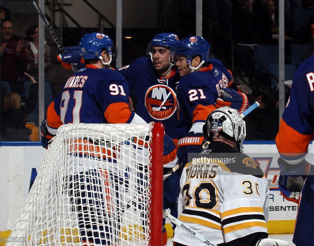 John Tavares Matt Moulson and Kyle Okposo of the New York Islanders celebrate Moulson's goal at 1958 of the second period against Tim Thomas of the...