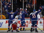 John Tavares Mikhail Grabovski and Johnny Boychuk of the New York Islanders celebrate a first period goal by Grabovski against the New York Rangers...