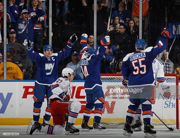 John Tavares Mikhail Grabovski and Johnny Boychuk of the New York Islanders celebrate a first period goal by Grabovski against the New York Rangers...