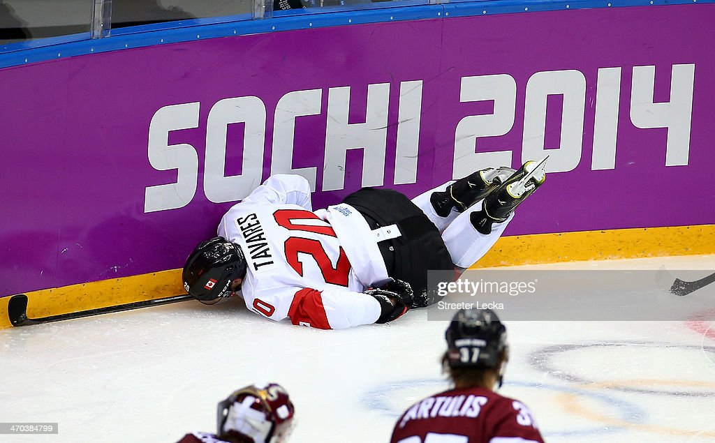 <a gi-track='captionPersonalityLinkClicked' href=/galleries/search?phrase=John+Tavares&family=editorial&specificpeople=601791 ng-click='$event.stopPropagation()'>John Tavares</a> #20 of Canada dives into the boards during the Men's Ice Hockey Quarterfinal Playoff against Latvia on Day 12 of the 2014 Sochi Winter Olympics at Bolshoy Ice Dome on February 19, 2014 in Sochi, Russia.