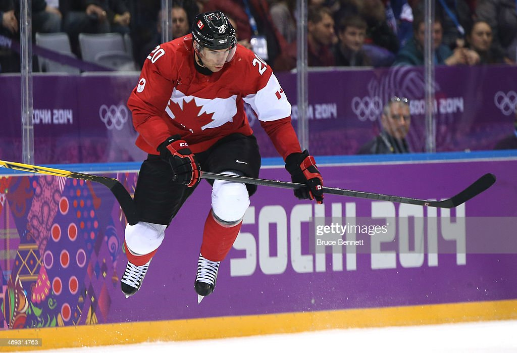 <a gi-track='captionPersonalityLinkClicked' href=/galleries/search?phrase=John+Tavares&family=editorial&specificpeople=601791 ng-click='$event.stopPropagation()'>John Tavares</a> #20 of Canada makes a leap during the Men's Ice Hockey Preliminary Round Group B game against Norway on day six of the Sochi 2014 Winter Olympics at Bolshoy Ice Dome on February 13, 2014 in Sochi, Russia.