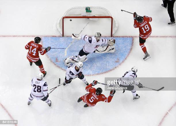 John Tavares of Team Canada scores a goal against Thomas McCollum of Team USA as team mates P K Subban and Jordan Eberle of Team Canada look on...
