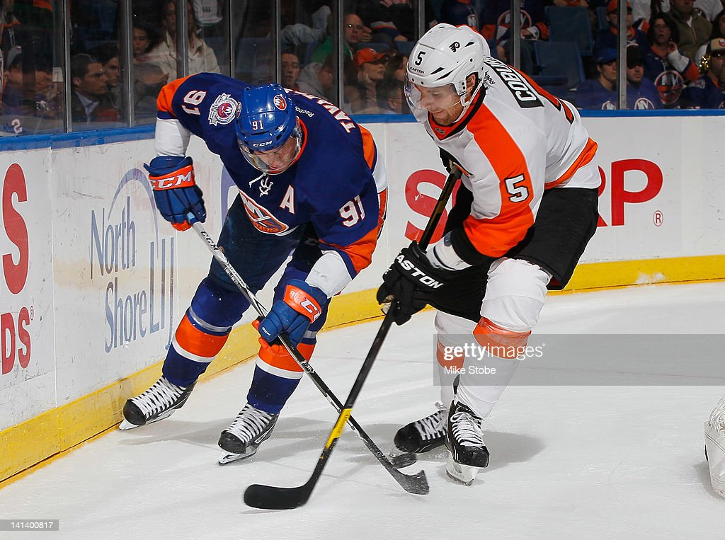 <a gi-track='captionPersonalityLinkClicked' href=/galleries/search?phrase=John+Tavares&family=editorial&specificpeople=601791 ng-click='$event.stopPropagation()'>John Tavares</a> #91 of the New York Islanders and <a gi-track='captionPersonalityLinkClicked' href=/galleries/search?phrase=Braydon+Coburn&family=editorial&specificpeople=2077063 ng-click='$event.stopPropagation()'>Braydon Coburn</a> #5 of the Philadelphia Flyers battle for the puck at Nassau Veterans Memorial Coliseum on March 15, 2012 in Uniondale, New York. The Philadelphia Flyers defeated the Islanders 3-2.
