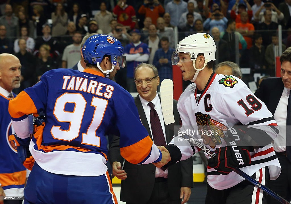 John Tavares #91 of the New York Islanders and Jonathan Toews #19 of the Chicago Blackhawks shakes hands prior to their game at the Barclays Center on October 9, 2015 in Brooklyn borough of New York City. The game is the first for the Islanders in their new arena. The Blackhawks defeated the Islanders 3-2 in overtime.