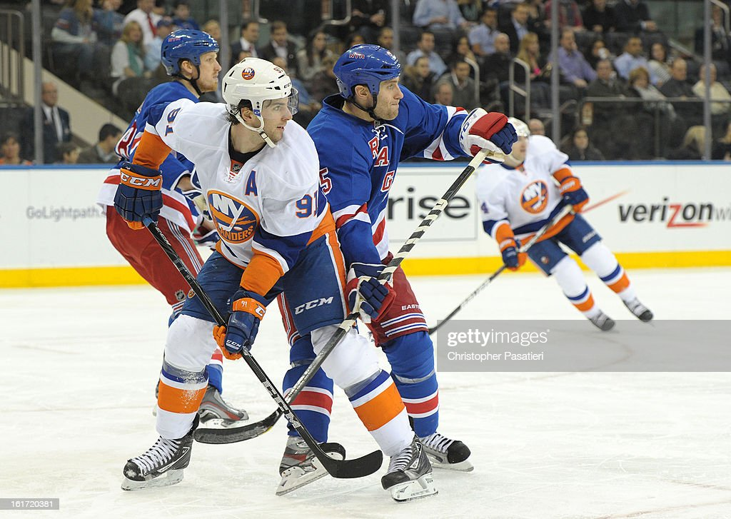 <a gi-track='captionPersonalityLinkClicked' href=/galleries/search?phrase=John+Tavares&family=editorial&specificpeople=601791 ng-click='$event.stopPropagation()'>John Tavares</a> #91 of the New York Islanders battles for position against Dan Girardi #5 of the New York Rangers on February 14, 2013 at Madison Square Garden in New York City.