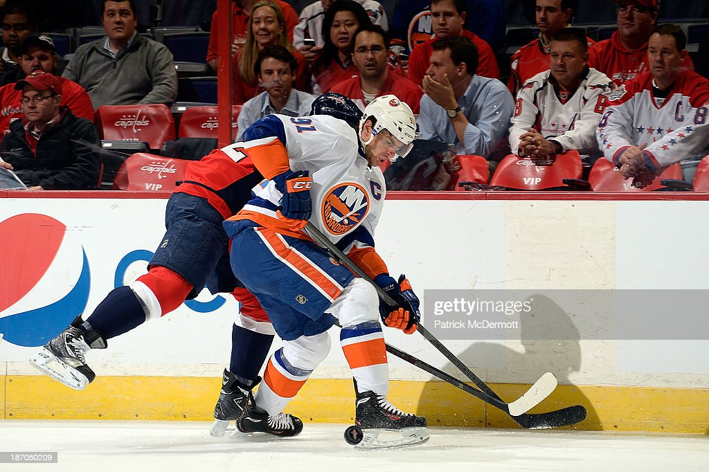 <a gi-track='captionPersonalityLinkClicked' href=/galleries/search?phrase=John+Tavares&family=editorial&specificpeople=601791 ng-click='$event.stopPropagation()'>John Tavares</a> #91 of the New York Islanders battles for the puck along the boards in the first period during an NHL game against the Washington Capitals at Verizon Center on November 5, 2013 in Washington, DC.