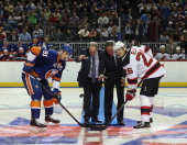 John Tavares of the New York Islanders Bruce Ratner Charles Wang and Patrik Elias of the New Jersey Devils take the ceremonial faceoff before a...