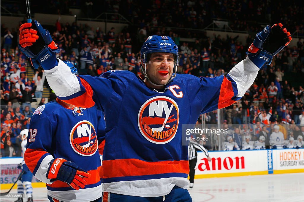 <a gi-track='captionPersonalityLinkClicked' href=/galleries/search?phrase=John+Tavares&family=editorial&specificpeople=601791 ng-click='$event.stopPropagation()'>John Tavares</a> #91 of the New York Islanders celebrates a first period goal scored by teammate Anders Lee #27 (not shown) against the Toronto Maple Leafs at Nassau Veterans Memorial Coliseum on February 12, 2015 in Uniondale, New York.