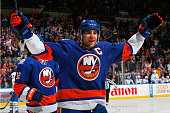 John Tavares of the New York Islanders celebrates a first period goal scored by teammate Anders Lee against the Toronto Maple Leafs at Nassau...