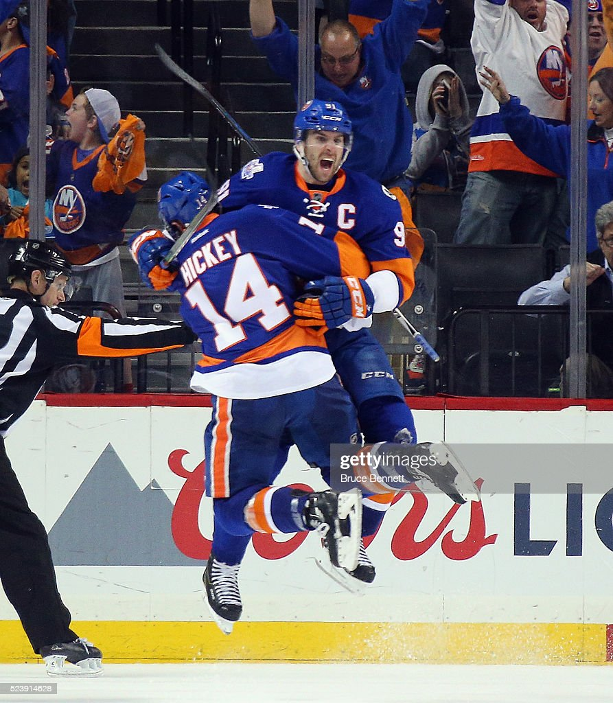 John Tavares #91 of the New York Islanders celebrates his game winning goal at 10:41 of the second overtime against the Florida Panthers and is joined by Thomas Hickey #14 in Game Six of the Eastern Conference First Round during the 2016 NHL Stanley Cup Playoffs at the Barclays Center on April 24, 2016 in the Brooklyn borough of New York City. The Islanders win the series 4 games to 2 to move on to the next round.