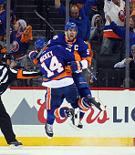 John Tavares of the New York Islanders celebrates his game winning goal at 1041 of the second overtime against the Florida Panthers and is joined by...