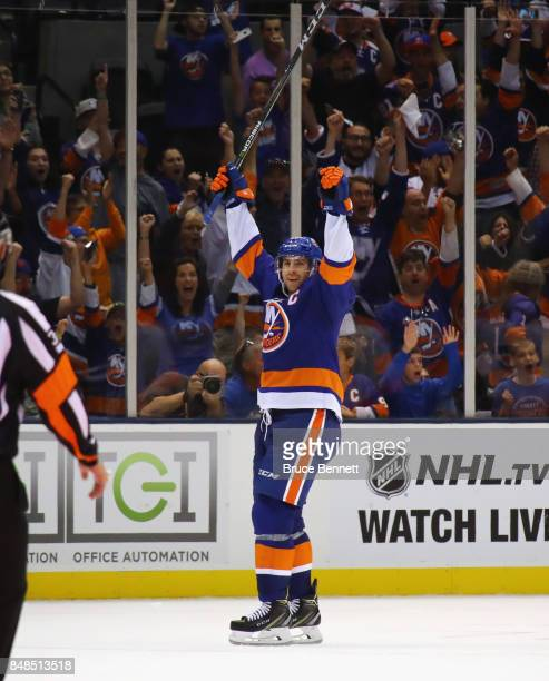 John Tavares of the New York Islanders celebrates his game winning goal at 34 seconds of overtime against the Philadelphia Flyers during a preseason...