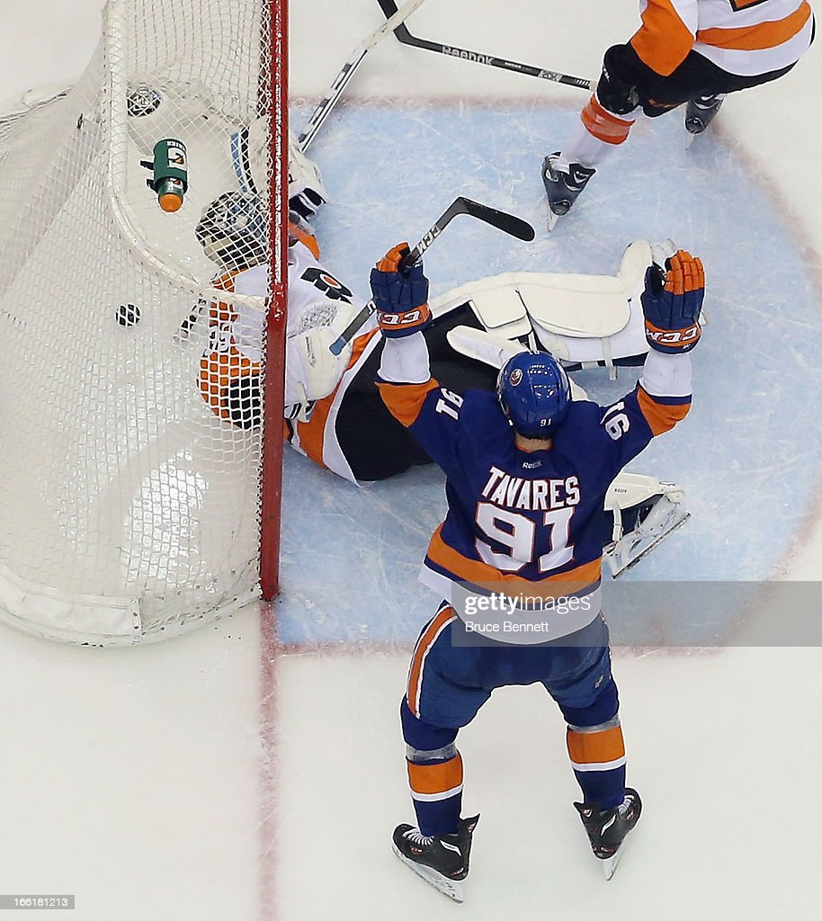 John Tavares #91 of the New York Islanders celebrates his goal at 18:23 of the third period against Steve Mason #35 of the Philadelphia Flyers at the Nassau Veterans Memorial Coliseum on April 9, 2013 in Uniondale, New York. The Islanders defeated the Flyers 4-1.