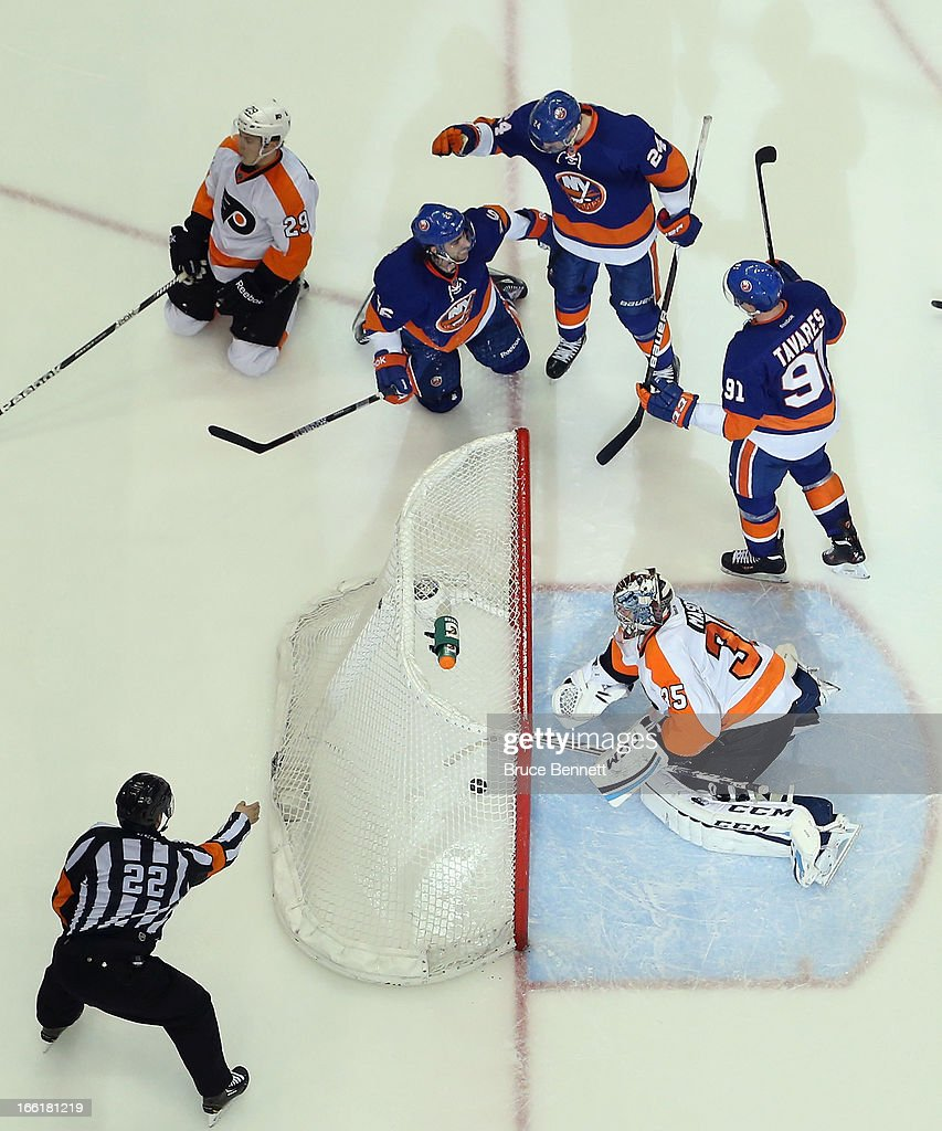 John Tavares #91 (R) of the New York Islanders celebrates his goal at 18:23 of the third period against Steve Mason #35 of the Philadelphia Flyers along with Matt Moulson #26 (L) and Brad Boyes #24 (C) at the Nassau Veterans Memorial Coliseum on April 9, 2013 in Uniondale, New York. The Islanders defeated the Flyers 4-1.