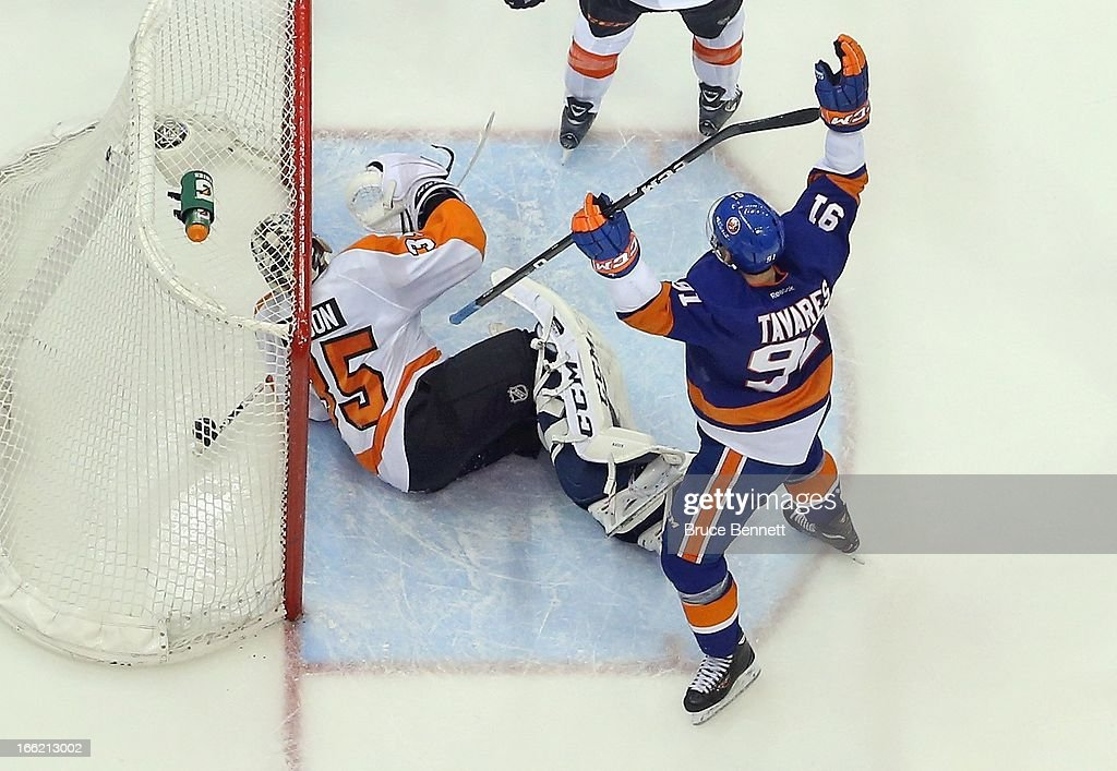 John Tavares #91 of the New York Islanders celebrates his goal at 18:23 of the third period against Steve Mason #35 of the Philadelphia Flyers at the Nassau Veterans Memorial Coliseum on April 9, 2013 in Uniondale, New York. The Islanders defeated the Flyers 4-1.