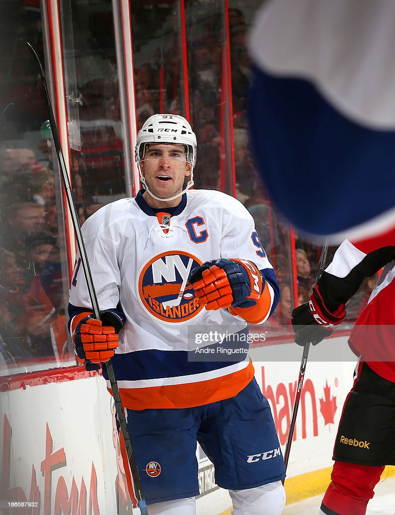 <a gi-track='captionPersonalityLinkClicked' href=/galleries/search?phrase=John+Tavares&family=editorial&specificpeople=601791 ng-click='$event.stopPropagation()'>John Tavares</a> #91 of the New York Islanders celebrates his second period goal against the Ottawa Senators at Canadian Tire Centre on November 1, 2013 in Ottawa, Ontario, Canada.