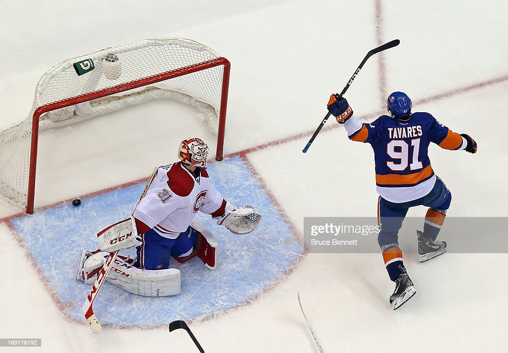 <a gi-track='captionPersonalityLinkClicked' href=/galleries/search?phrase=John+Tavares&family=editorial&specificpeople=601791 ng-click='$event.stopPropagation()'>John Tavares</a> #91 of the New York Islanders celebrates his third period goal against <a gi-track='captionPersonalityLinkClicked' href=/galleries/search?phrase=Carey+Price&family=editorial&specificpeople=2222083 ng-click='$event.stopPropagation()'>Carey Price</a> #31 of the Montreal Canadiens at the Nassau Veterans Memorial Coliseum on March 5, 2013 in Uniondale, New York. The Islanders defeated the Canadiens 6-3.