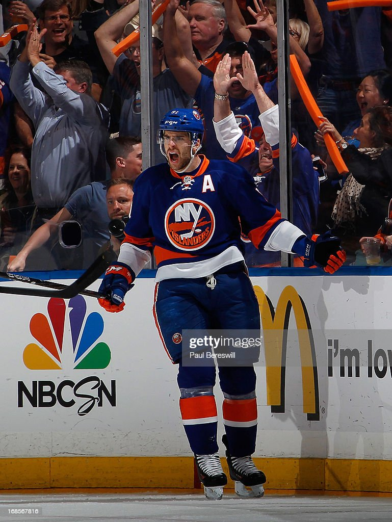 <a gi-track='captionPersonalityLinkClicked' href=/galleries/search?phrase=John+Tavares&family=editorial&specificpeople=601791 ng-click='$event.stopPropagation()'>John Tavares</a> #91 of the New York Islanders cheers his goal along with fans in the first period against the Pittsburgh Penguins in Game Six of the Eastern Conference Quarterfinals during the 2013 NHL Stanley Cup Playoffs at Nassau Veterans Memorial Coliseum on May 11, 2013 in Uniondale, New York.