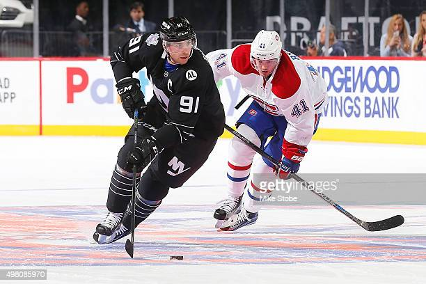 John Tavares of the New York Islanders controls the puck in front of Paul Byron of the Montreal Canadiens during the game at the Barclays Center on...