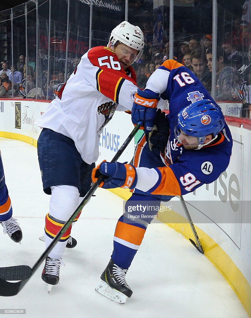 John Tavares #91 of the New York Islanders is checked by Michael Matheson #56 of the Florida Panthersin Game Six of the Eastern Conference First Round during the 2016 NHL Stanley Cup Playoffs at the Barclays Center on April 24, 2016 in the Brooklyn borough of New York City. The Islanders won the game 2-1 in double overtime to win the series four games to two.
