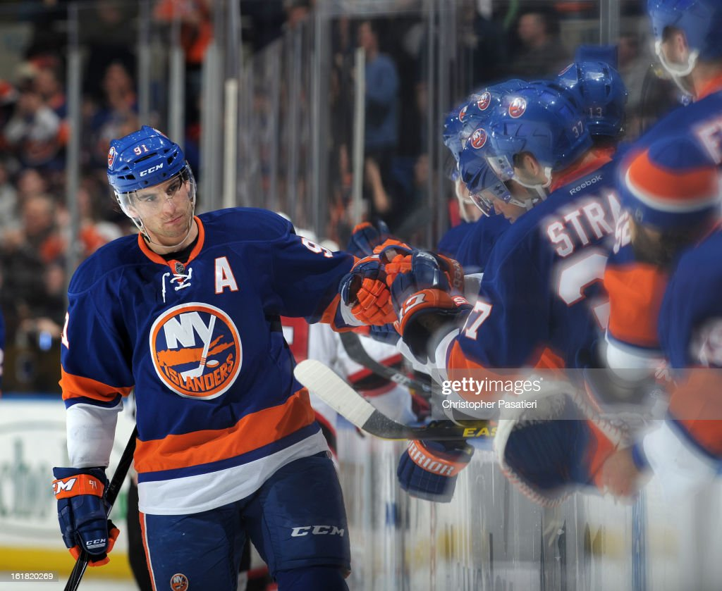 John Tavares #91 of the New York Islanders is congratulated after scoring his third goal of the game against the New Jersey Devils on February 16, 2013 at Nassau Veterans Memorial Coliseum in Uniondale, New York.