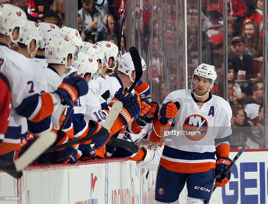 John Tavares #91 of the New York Islanders is congratulated by teammates on the bench after he scored a goal in the second period against the New Jersey Devils at the Prudential Center on January 31, 2013 in Newark, New Jersey.