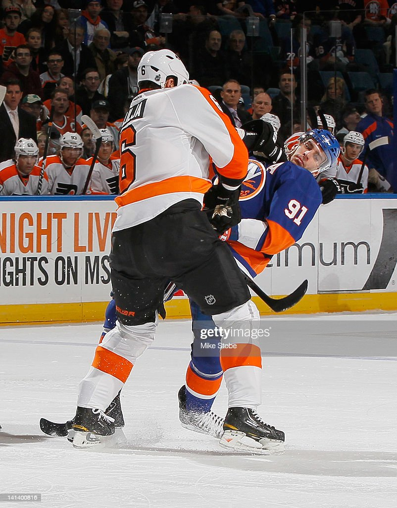 <a gi-track='captionPersonalityLinkClicked' href=/galleries/search?phrase=John+Tavares&family=editorial&specificpeople=601791 ng-click='$event.stopPropagation()'>John Tavares</a> #91 of the New York Islanders is shoved by <a gi-track='captionPersonalityLinkClicked' href=/galleries/search?phrase=Andreas+Lilja&family=editorial&specificpeople=210774 ng-click='$event.stopPropagation()'>Andreas Lilja</a> #6 of the Philadelphia Flyers at Nassau Veterans Memorial Coliseum on March 15, 2012 in Uniondale, New York. The Philadelphia Flyers defeated the Islanders 3-2.