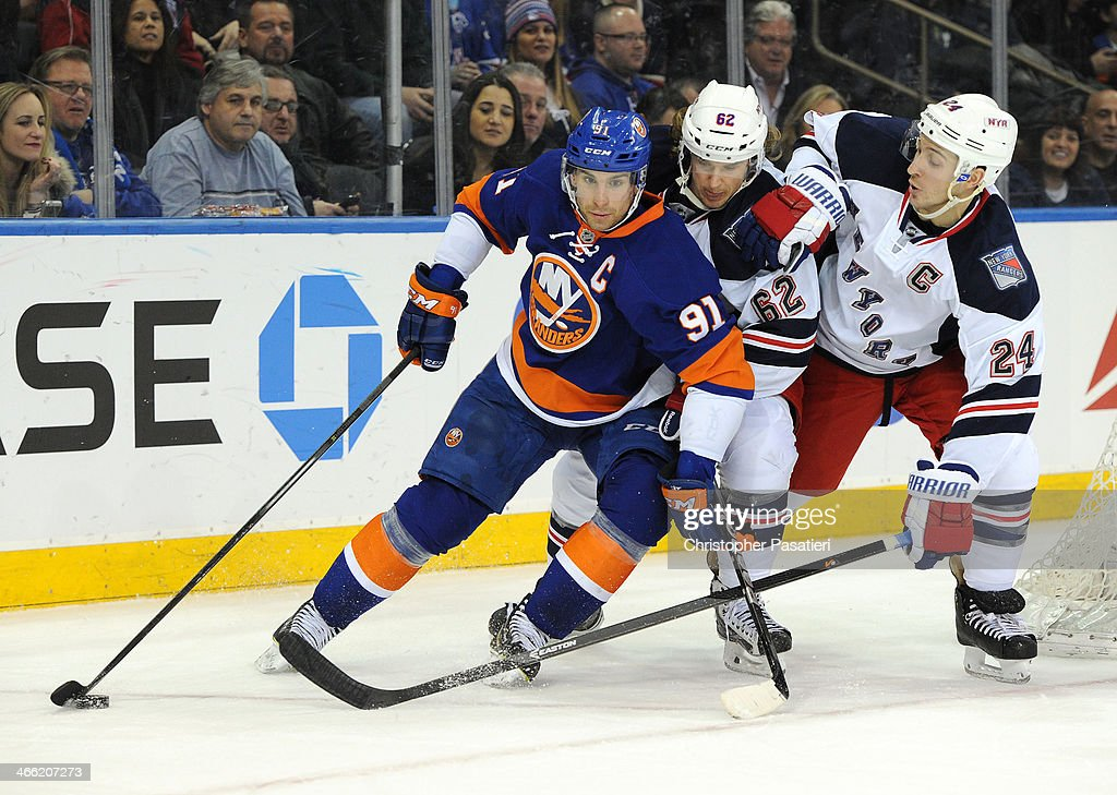 <a gi-track='captionPersonalityLinkClicked' href=/galleries/search?phrase=John+Tavares&family=editorial&specificpeople=601791 ng-click='$event.stopPropagation()'>John Tavares</a> #91 of the New York Islanders keeps <a gi-track='captionPersonalityLinkClicked' href=/galleries/search?phrase=Carl+Hagelin&family=editorial&specificpeople=4465394 ng-click='$event.stopPropagation()'>Carl Hagelin</a> #62 and <a gi-track='captionPersonalityLinkClicked' href=/galleries/search?phrase=Ryan+Callahan&family=editorial&specificpeople=809690 ng-click='$event.stopPropagation()'>Ryan Callahan</a> #24 of the New York Rangers off the puck during the third period on January 31, 2014 at Madison Square Garden in New York City.