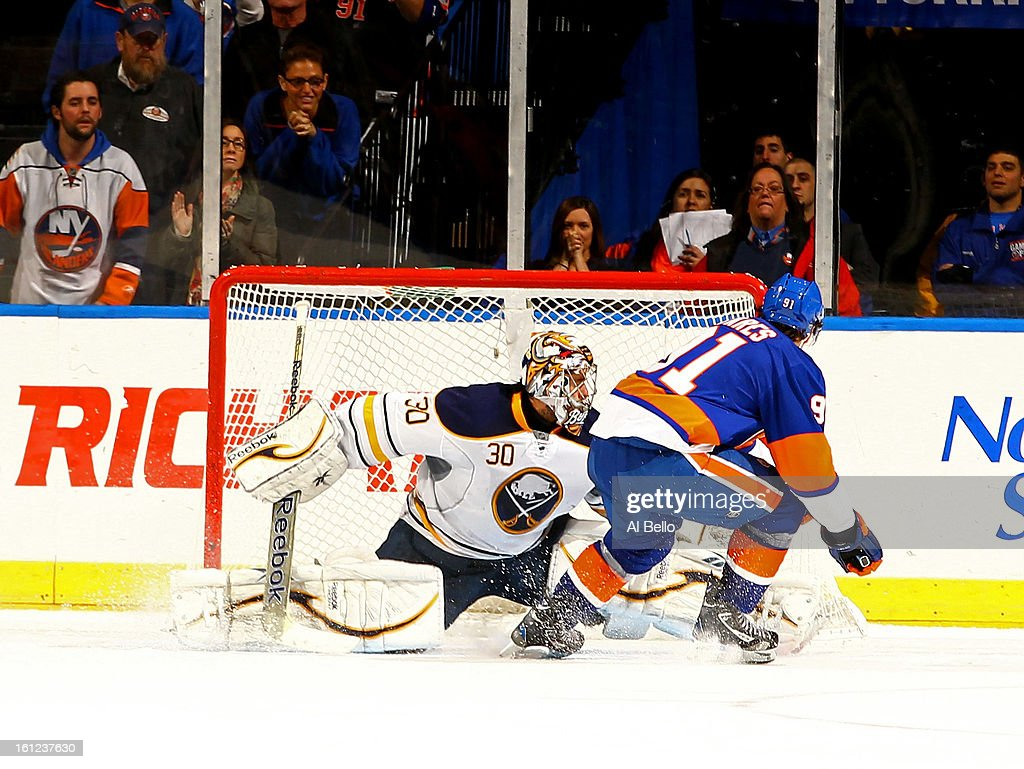 John Tavares #91 of the New York Islanders misses a penalty shot against Ryan Miller #30 of the Buffalo Sabres during their game at Nassau Veterans Memorial Coliseum on February 9, 2013 in Uniondale, New York.