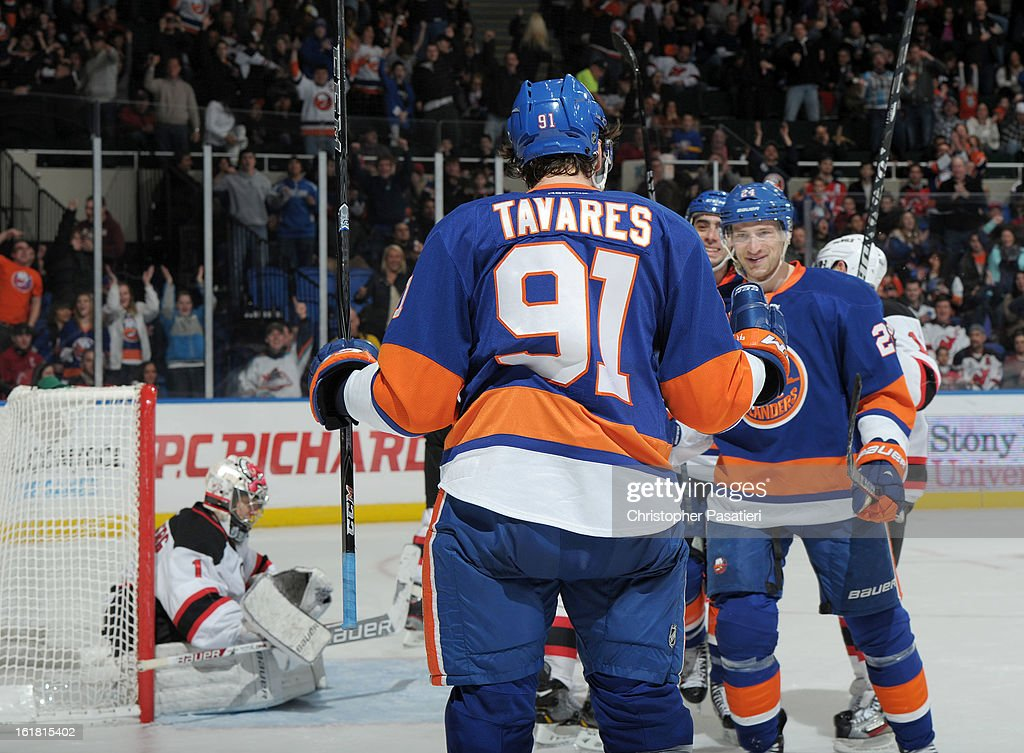 John Tavares #91 of the New York Islanders reacts after scoring his second goal of the game against the New Jersey Devils on February 16, 2013 at Nassau Veterans Memorial Coliseum in Uniondale, New York.
