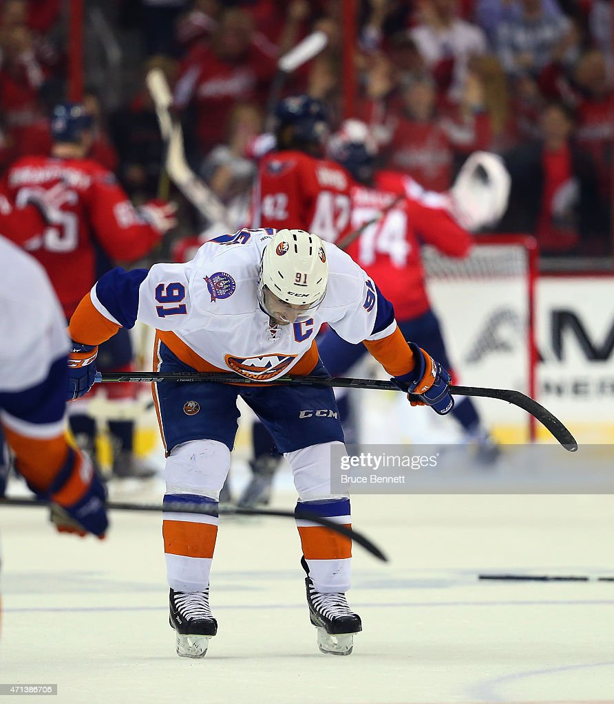 <a gi-track='captionPersonalityLinkClicked' href=/galleries/search?phrase=John+Tavares&family=editorial&specificpeople=601791 ng-click='$event.stopPropagation()'>John Tavares</a> #91 of the New York Islanders reacts at the end of a 2-1 loss to the Washington Capitals in Game Seven of the Eastern Conference Quarterfinals during the 2015 NHL Stanley Cup Playoffs at Verizon Center on April 27, 2015 in Washington, DC.