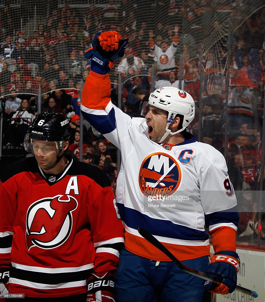 <a gi-track='captionPersonalityLinkClicked' href=/galleries/search?phrase=John+Tavares&family=editorial&specificpeople=601791 ng-click='$event.stopPropagation()'>John Tavares</a> #91 of the New York Islanders scores at 13:47 of the second period against the New Jersey Devils to tie the score at 2-2 at the Prudential Center on January 9, 2015 in Newark, New Jersey. The Islanders defeated the Devils 3-2 in overtime.