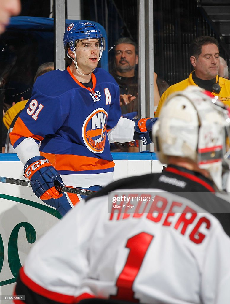 <a gi-track='captionPersonalityLinkClicked' href=/galleries/search?phrase=John+Tavares&family=editorial&specificpeople=601791 ng-click='$event.stopPropagation()'>John Tavares</a> #91 of the New York Islanders scores his 3rd goal of the game against <a gi-track='captionPersonalityLinkClicked' href=/galleries/search?phrase=Johan+Hedberg&family=editorial&specificpeople=202078 ng-click='$event.stopPropagation()'>Johan Hedberg</a> #1 of the New Jersey Devils at Nassau Veterans Memorial Coliseum on February 16, 2013 in Uniondale, New York. The Islanders defeated the Devils 5-1.