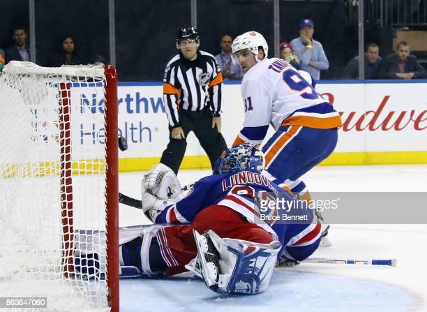 John Tavares of the New York Islanders scores on the shootout against Henrik Lundqvist of the New York Rangers at Madison Square Garden on October 19...
