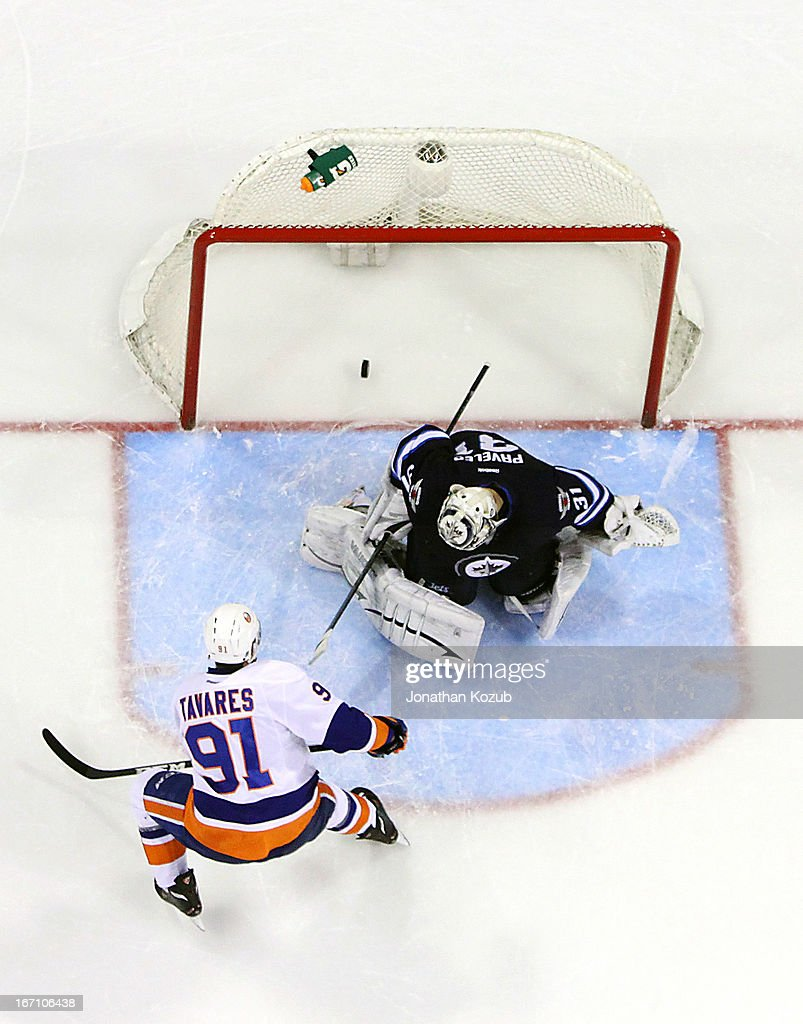 <a gi-track='captionPersonalityLinkClicked' href=/galleries/search?phrase=John+Tavares&family=editorial&specificpeople=601791 ng-click='$event.stopPropagation()'>John Tavares</a> #91 of the New York Islanders scores the game winning shootout goal against Ondrej Pavelec #31 of the Winnipeg Jets at the MTS Centre on April 20, 2013 in Winnipeg, Manitoba, Canada.