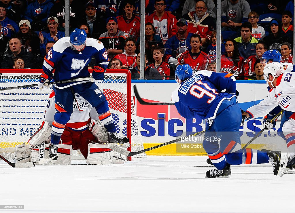 <a gi-track='captionPersonalityLinkClicked' href=/galleries/search?phrase=John+Tavares&family=editorial&specificpeople=601791 ng-click='$event.stopPropagation()'>John Tavares</a> #91 of the New York Islanders scores the game winning goal with 24 seconds left in overtime to defeat the Washington Capitals at Nassau Veterans Memorial Coliseum on November 26, 2014 in Uniondale, New York. The New York Islanders defeated the Washington Capitals 3-2.
