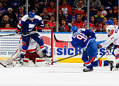 John Tavares of the New York Islanders scores the game winning goal with 24 seconds left in overtime to defeat the Washington Capitals at Nassau...
