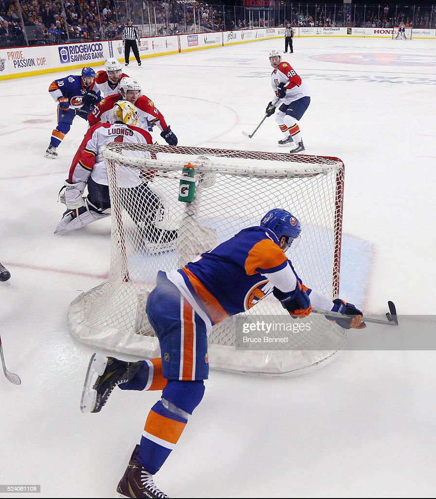 <a gi-track='captionPersonalityLinkClicked' href=/galleries/search?phrase=John+Tavares&family=editorial&specificpeople=601791 ng-click='$event.stopPropagation()'>John Tavares</a> #91 of the New York Islanders scores the game winning goal at 10:41 of the second overtime against <a gi-track='captionPersonalityLinkClicked' href=/galleries/search?phrase=Roberto+Luongo&family=editorial&specificpeople=202638 ng-click='$event.stopPropagation()'>Roberto Luongo</a> #1 of the Flrorida Panthers in Game Six of the Eastern Conference First Round during the 2016 NHL Stanley Cup Playoffs at the Barclays Center on April 24, 2016 in the Brooklyn borough of New York City. The Islanders won the game 2-1 in double overtime to win the series four games to two.