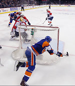 John Tavares of the New York Islanders scores the game winning goal at 1041 of the second overtime against Roberto Luongo of the Flrorida Panthers in...