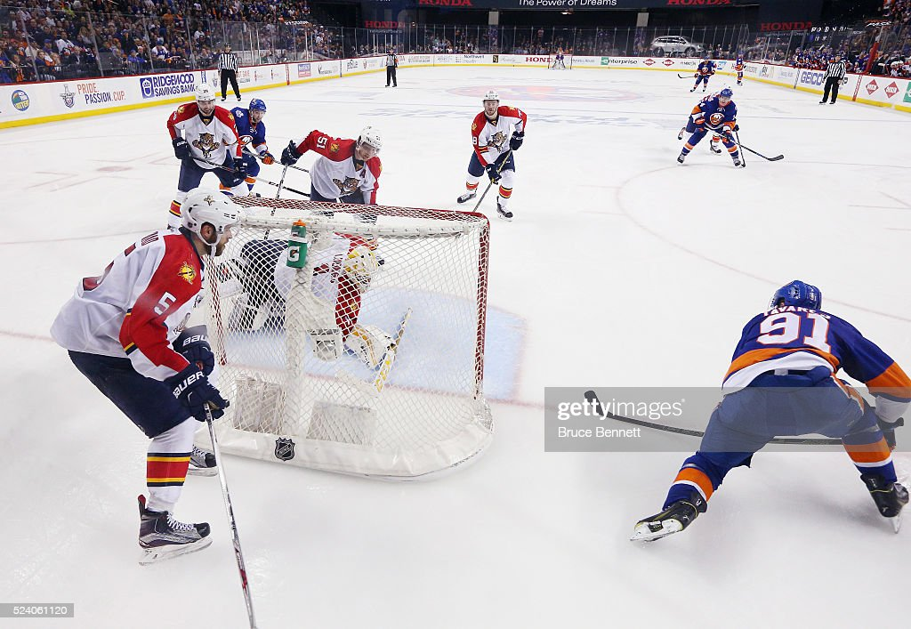 John Tavares #91 of the New York Islanders scores the game winning goal at 10:41 of the second overtime against Roberto Luongo #1 of the Flrorida Panthers in Game Six of the Eastern Conference First Round during the 2016 NHL Stanley Cup Playoffs at the Barclays Center on April 24, 2016 in the Brooklyn borough of New York City. The Islanders won the game 2-1 in double overtime to win the series four games to two.