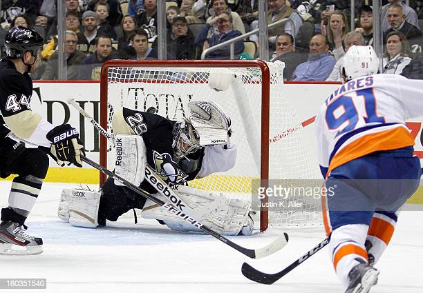 John Tavares of the New York Islanders shoots and scores a power play goal against MarcAndre Fleury of the Pittsburgh Penguins during the game at...