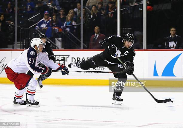 John Tavares of the New York Islanders shoots as Ryan Murray of the Columbus Blue Jackets defends during their game at the Barclays Center on January...