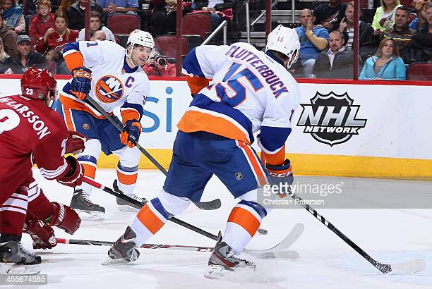 John Tavares of the New York Islanders shoots to score a second period goal against the Phoenix Coyotes during the NHL game at Jobingcom Arena on...