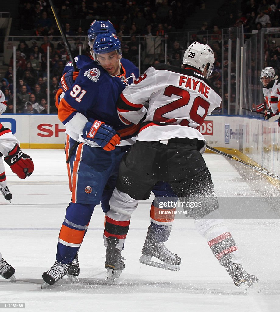 <a gi-track='captionPersonalityLinkClicked' href=/galleries/search?phrase=John+Tavares&family=editorial&specificpeople=601791 ng-click='$event.stopPropagation()'>John Tavares</a> #91 of the New York Islanders skates against Mark Fayne #29 of the New Jersey Devils at the Nassau Veterans Memorial Coliseum on March 10, 2012 in Uniondale, New York. The Devils defeated the Islanders 2-1.