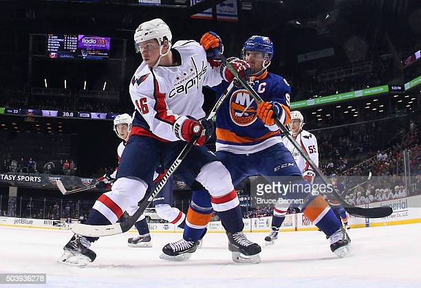 John Tavares of the New York Islanders skates against Michael Latta of the Washington Capitals at the Barclays Center on January 7 2016 in the...
